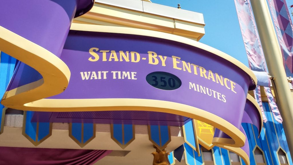 a sign showing the wait time for a popular disney attraction