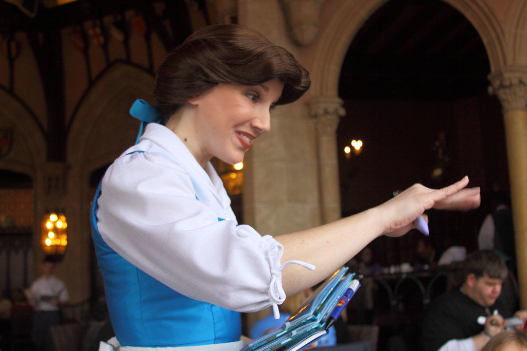 cinderella visiting with guests inside Cinderella's Castle
