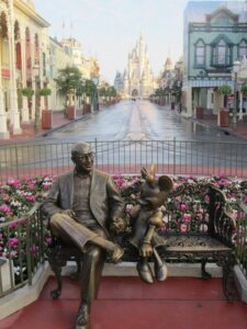 Roy Disney sitting with Minnie Mouse