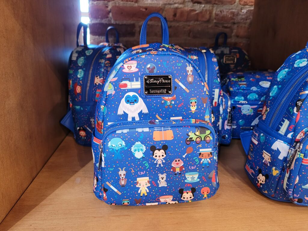 Disney Park Attractions Loungefly Backpack in World of Disney at Disney Springs