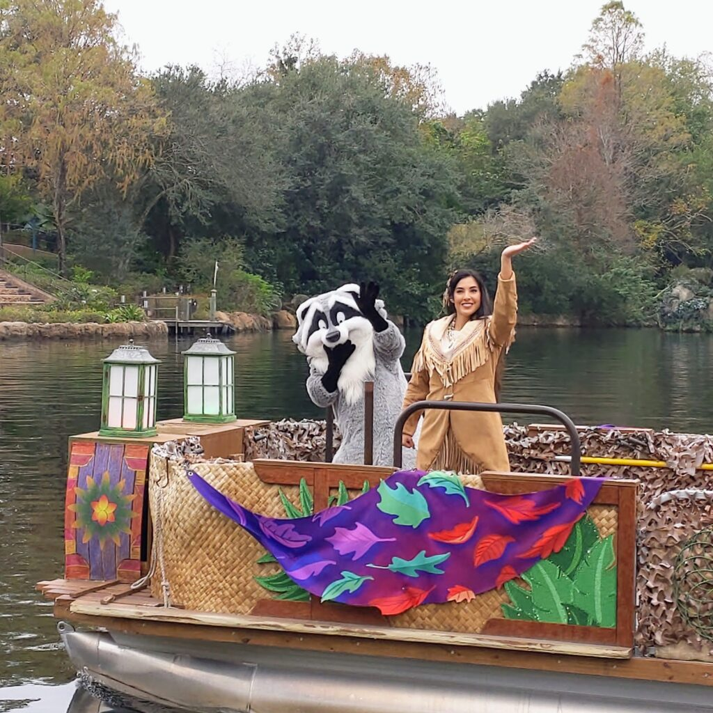 Pocahontas and Miko Characters on Boat in Animal Kingdom