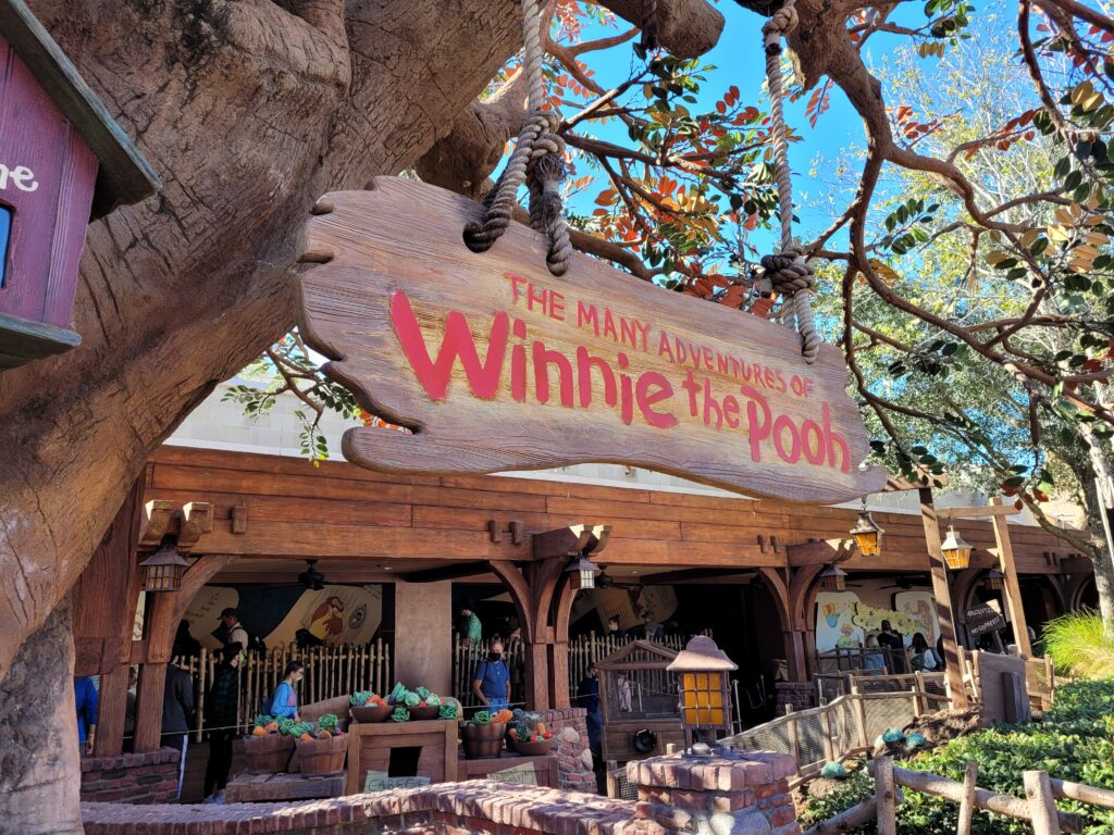 The Many Adventures of Winnie the Pooh Sign