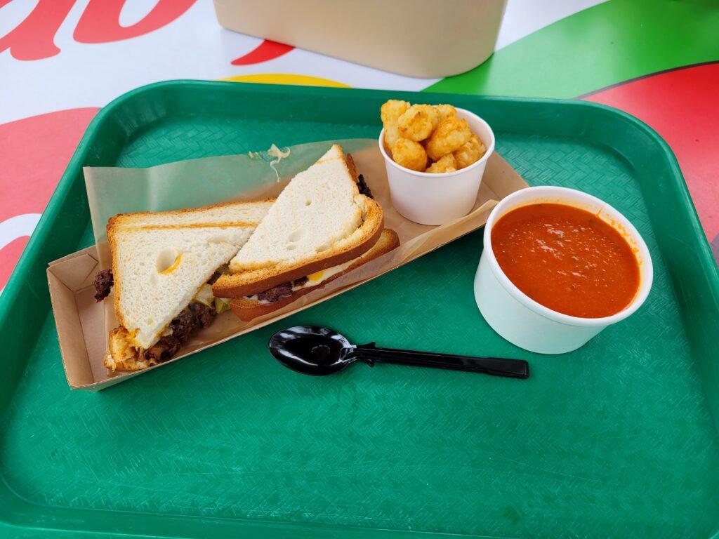 BBQ Brisket Sandwich, Potato Barrels, Tomato Soup from Woody's Lunchbox