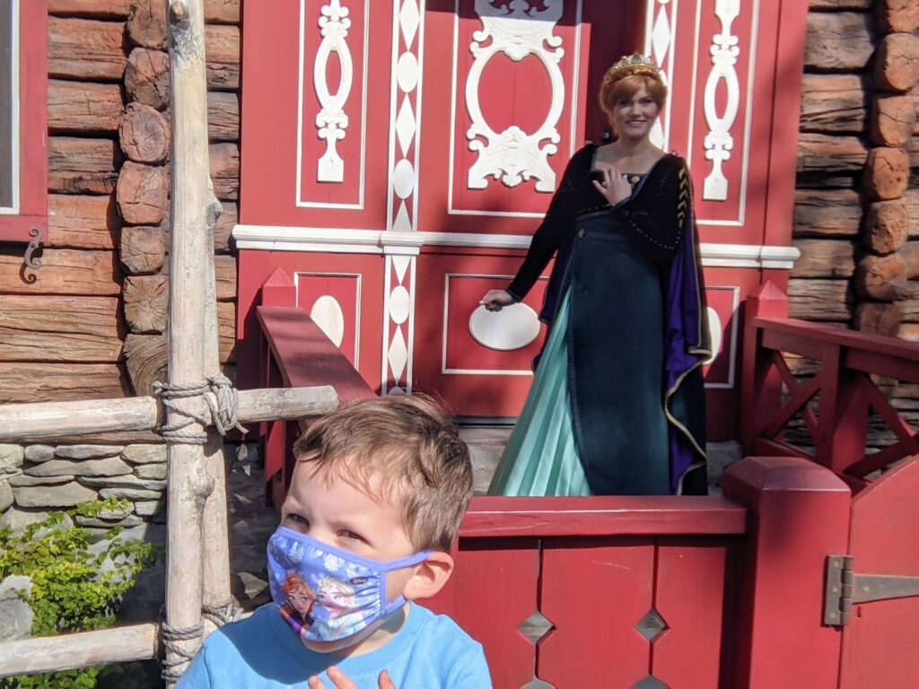 Lincoln Sports His Frozen Mask While Meeting Anna at Royal Summerhus in Epcot