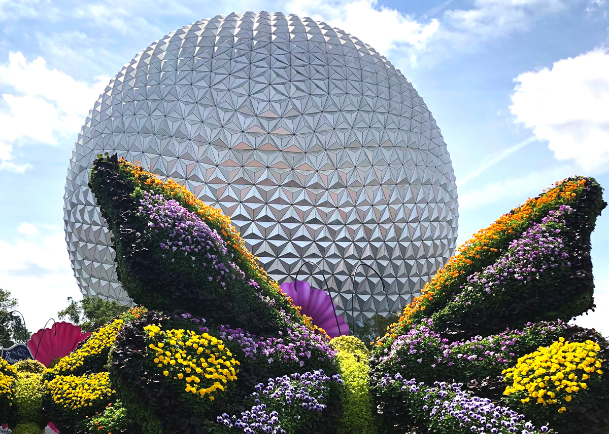 Exterior photo of Spaceship Earth with butterfly topiary