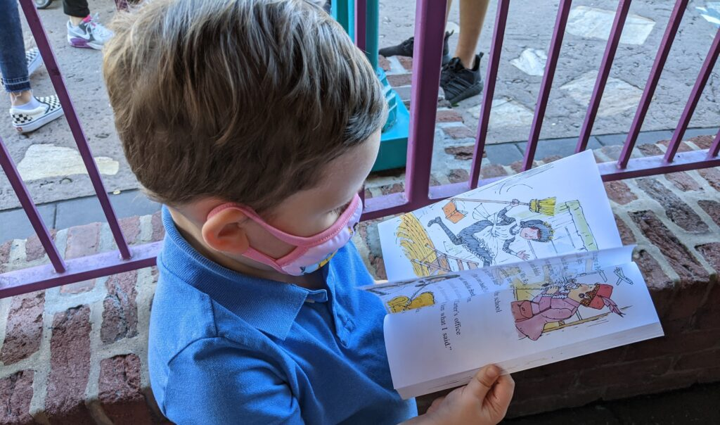 Lincoln Reading His Favorite Book In Line at Disney World