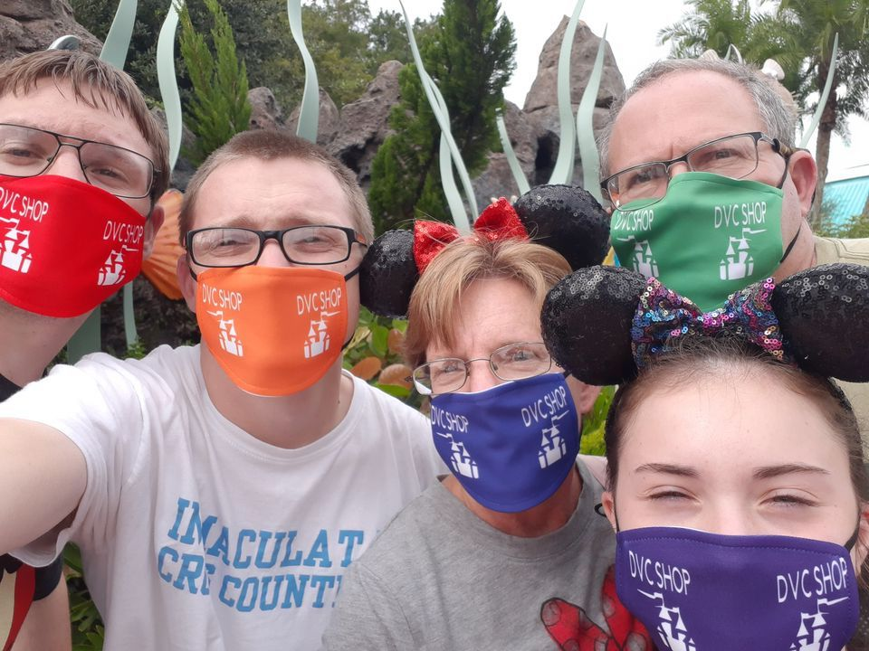 Family with DVC Shop Masks on at the Park