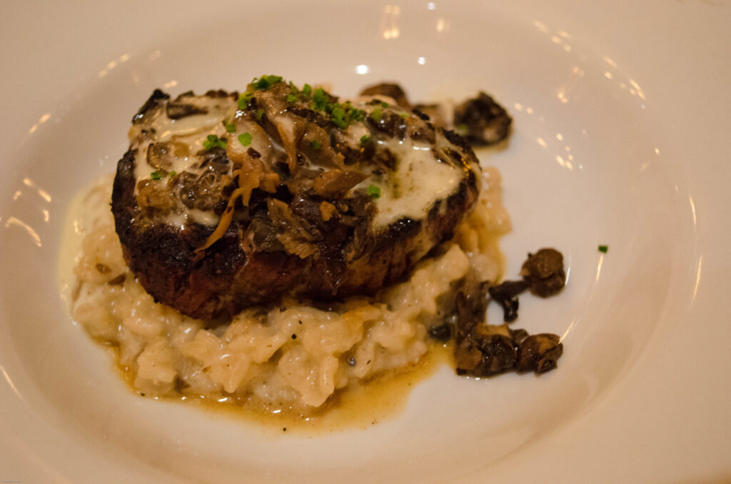 Petite Fillet mignon with Mushroom Risotto at Le Cellier in Epcot by dawnmichele