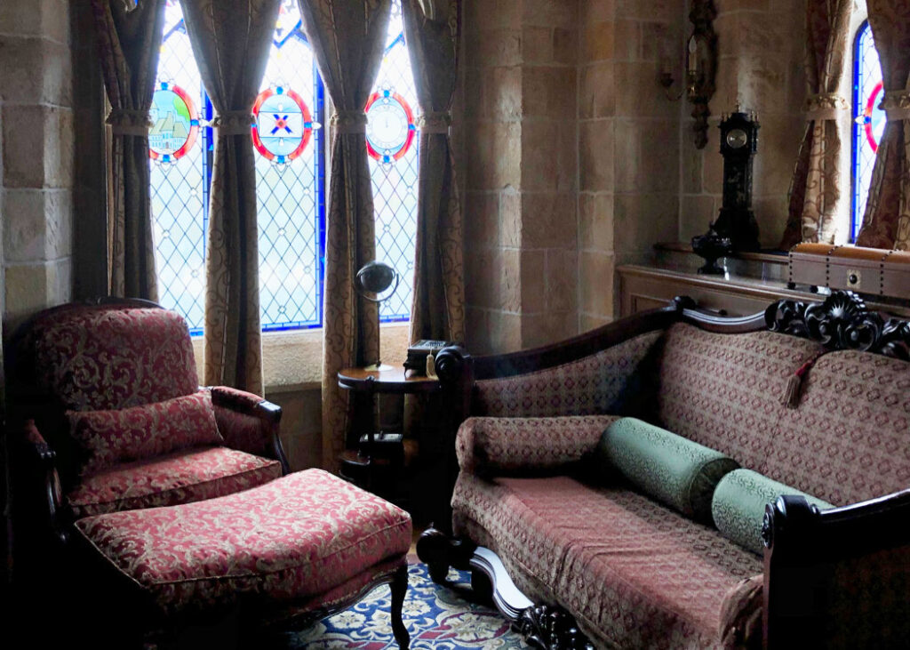 Cinderella Castle Suite study with sofa bed and armchair