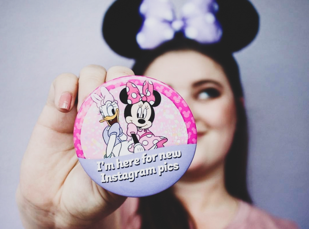Girl holding Instagram Minnie and Daisy Disney Button