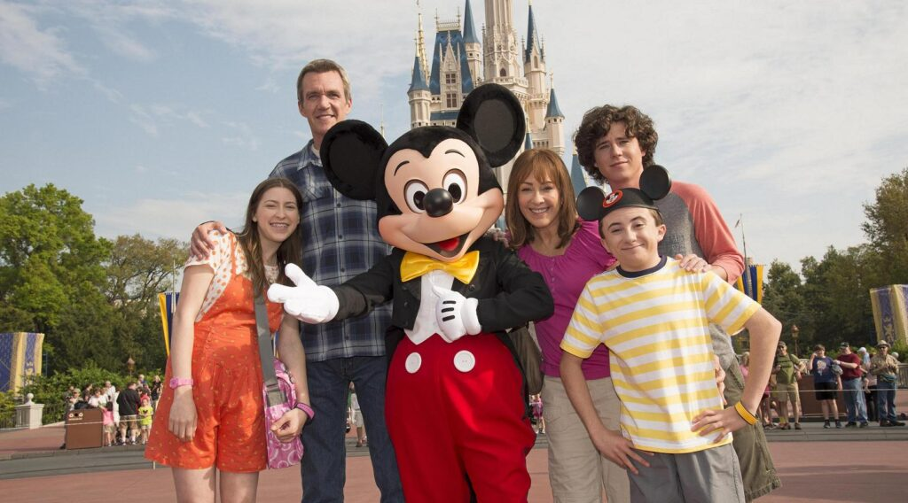 The Family from the Middle TV show in front of Cinderella Castle.