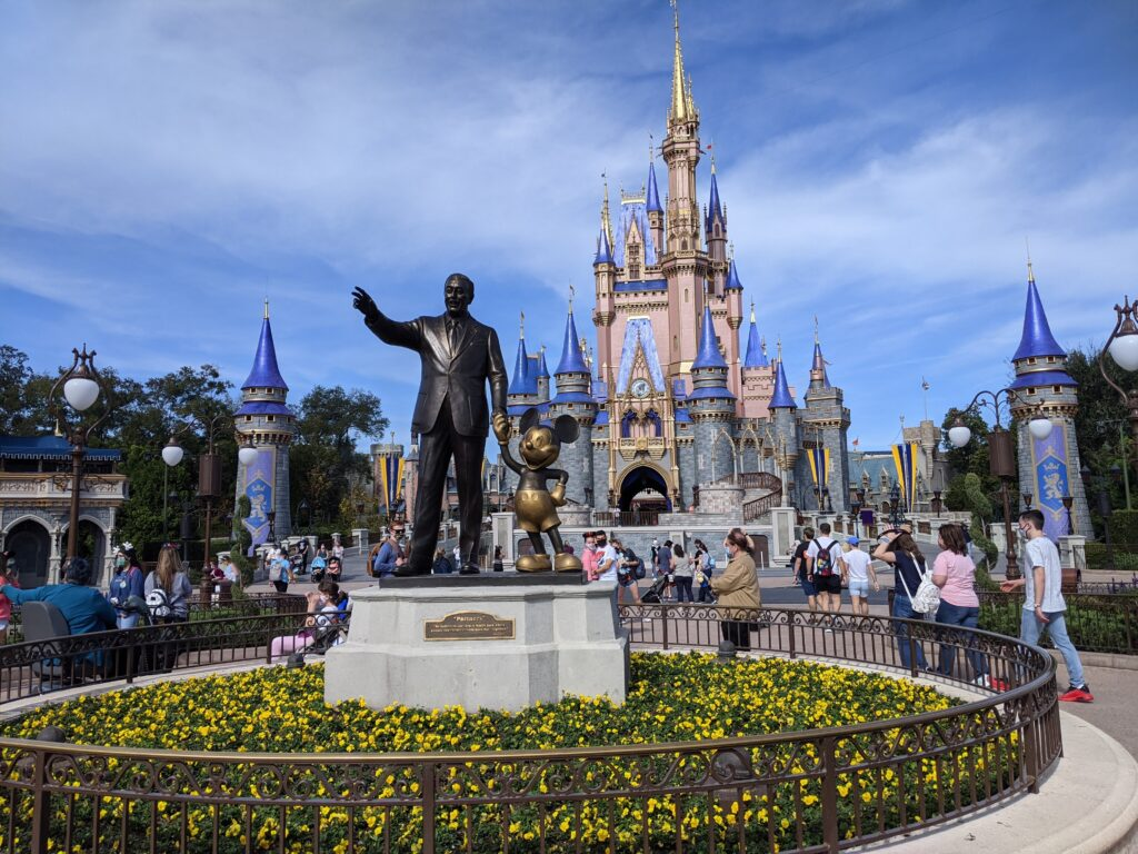 walt and mickey in front of Cinderella's castle