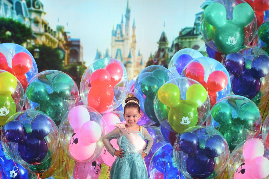 Girl in princess costume with Disney World backdrop