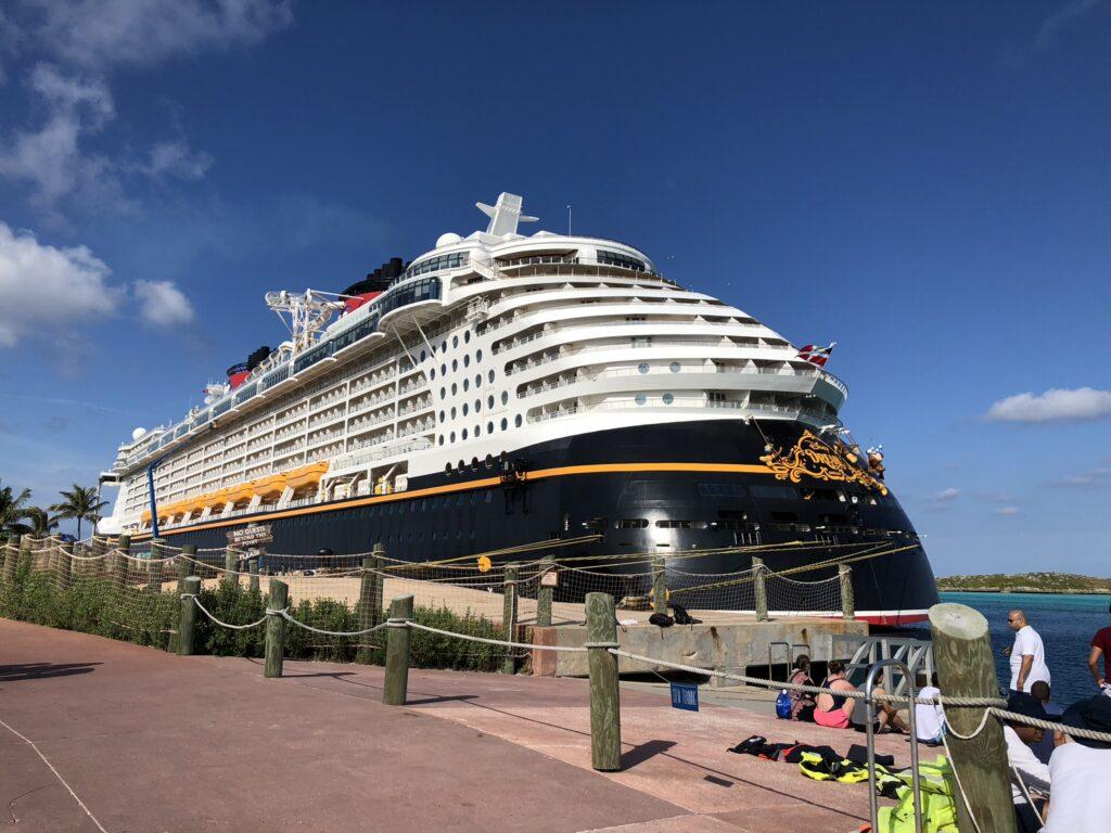 Disney Cruise docked at port.