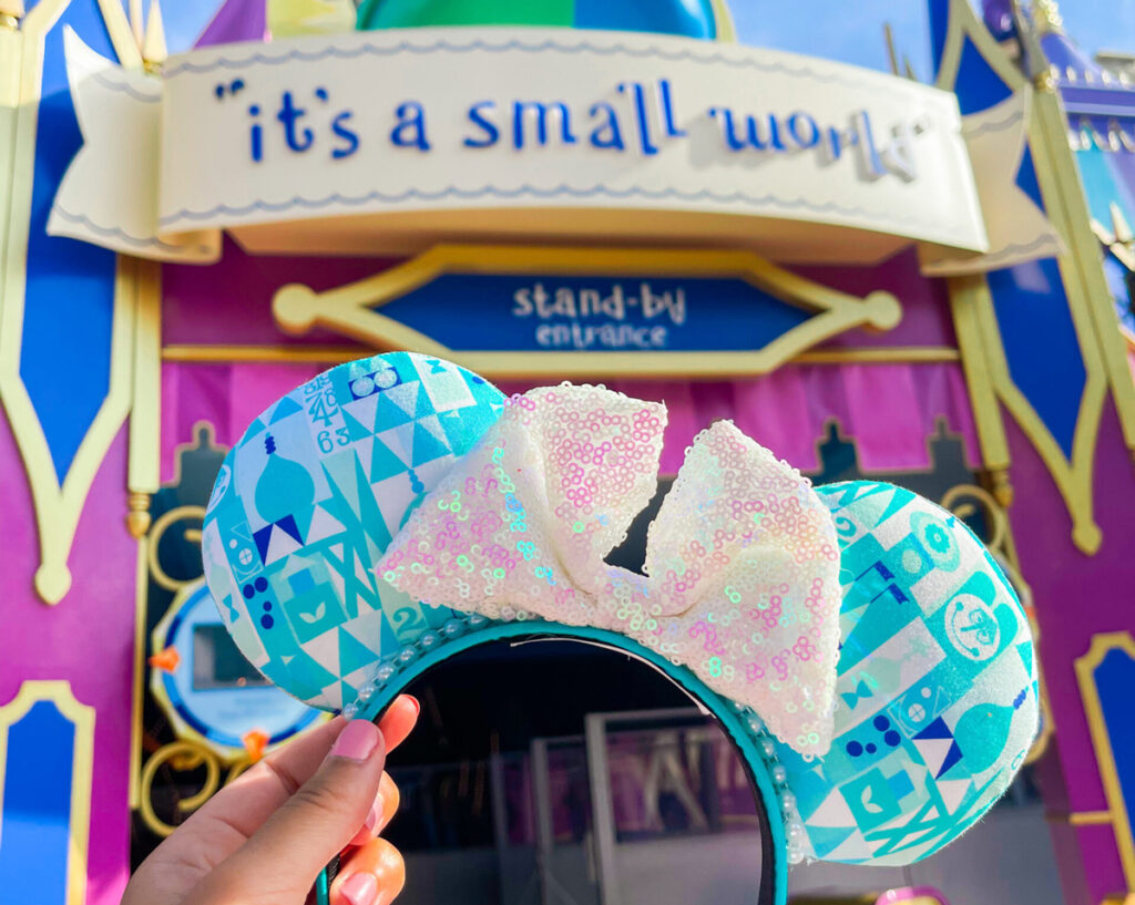 It's a small world Disney attraction with Minnie ears